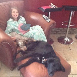 Maddie chilling with the dogs